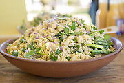 """Buck"" barley pasta salad with asparagus, snap peas, preserved lemon, & ricotta salad"