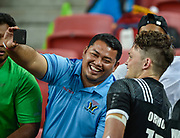 New Zealand's Lewis Ormond poses for selfie's with fans after the HSBC World Rugby Sevens Series - Singapore match New Zealand -V- South Africa at The National Stadium, Singapore on Sunday, April 16, 2017. (Steve Flynn/Image of Sport)