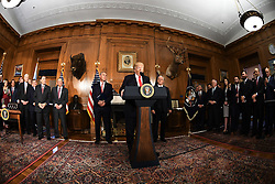April 26, 2017 - Washington, DC, United States of America - U.S President Donald Trump along with Interior Secretary Ryan Zinke, left, and Vice President Mike Pence, right, speaks before signing the Antiquities Executive Order at the Interior Department April 26, 2017 in Washington, D.C. The order calls into question the future of dozens of national monuments and will allow companies to mine and drill for oil in protected lands. (Credit Image: © Interior Department/Planet Pix via ZUMA Wire)