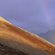 A rainbow over the Alaska Mountain Range at Sable Pass. Denali National Park, Alaska