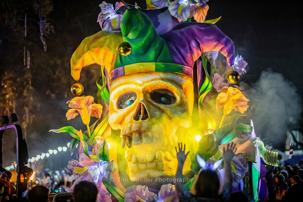 The Le Krewe d'Etat Title float turns onto St. Charles Avenue during Mardi Gras in New Orleans, La. Le Krewe d'Etat offers a satirical theme and historically parades on the Friday before Fat Tuesday.