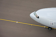 Aerial view (from control tower) of generic airliner at London Heathrow airport.