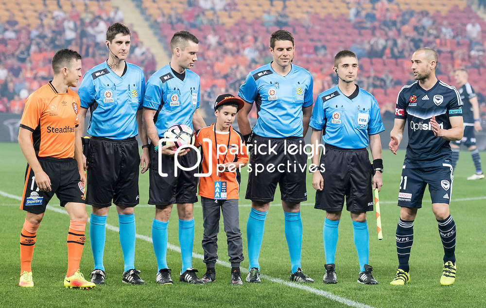 BRISBANE, AUSTRALIA - OCTOBER 7: Matt McKay of the Roar and Carl Valeri of the Victory toss the coin during the round 1 Hyundai A-League match between the Brisbane Roar and Melbourne Victory at Suncorp Stadium on October 7, 2016 in Brisbane, Australia. (Photo by Patrick Kearney/Brisbane Roar)