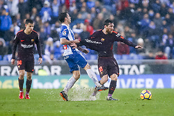 February 4, 2018 - Barcelona, Catalonia, Spain - RCD Espanyol midfielder Victor Sanchez (4) and FC Barcelona forward Lionel Messi (10) during the match between RCD Espanyol vs FC Barcelona, for the round 22 of the Liga Santander, played at Cornella -El Prat Stadium on 4th February 2018 in Barcelona, Spain. (Credit Image: © Urbanandsport/NurPhoto via ZUMA Press)