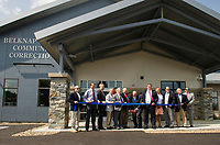 Superintendent Keith Gray cuts the ribbon in front of the Belknap County Corrections Facility during their grand opening ceremony Thursday afternoon.  (Karen Bobotas/for the Laconia Daily Sun)