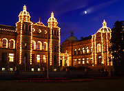 Rising moon over Parliament Buildings, Victoria, British Columbia, Canada.