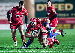 Scarlets' Josh Macleod is tackled by Leinster's Josh Murphy<br /> <br /> Photographer Craig Thomas/Replay Images<br /> <br /> Guinness PRO14 Round 17 - Scarlets v Leinster - Friday 9th March 2018 - Parc Y Scarlets - Llanelli<br /> <br /> World Copyright © Replay Images . All rights reserved. info@replayimages.co.uk - http://replayimages.co.uk