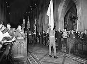 An Irish Army flag and the flags of the Royal British Legion are trooped to the altar during the Remembrance Day Service.<br /> 13 November 1983