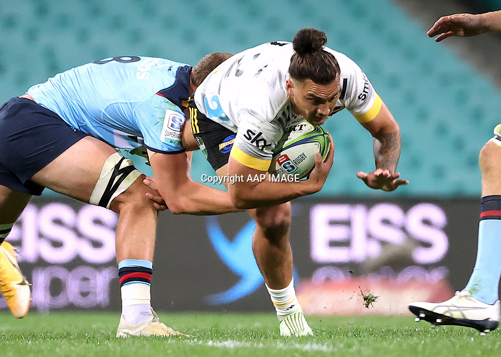 Will Harris from the NSW Waratahs tackles Peter Umaga-Jensen (R) of the Wellington Hurricanes during the Round 1 Trans-Tasman Super Rugby match between the NSW Waratahs and the Wellington Hurricanes at the SCG in Sydney, Friday, May 14, 2021.  (AAP Image/David Gray) NO ARCHIVING, EDITORIAL USE ONLY