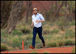 Press Officer Nick Loughran,runs to get out of the way of the media as The Duke and Duchess of Cambridge visit Uluru (Ayers Rock) Uluru, Australia, on day 16 of their Royal Tour of New Zealand and Australia, Tuesday, 22nd April 2014. Picture by Andrew Parsons / i-Images