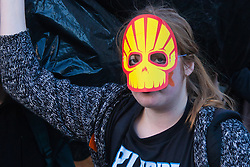 London, March 7th 2015. Following the Climate march through London, masked anarchists and environmental activists clash with police following a breakaway protest at Shell House. PICTURED: A protester's skull mask made from the Shell logo.