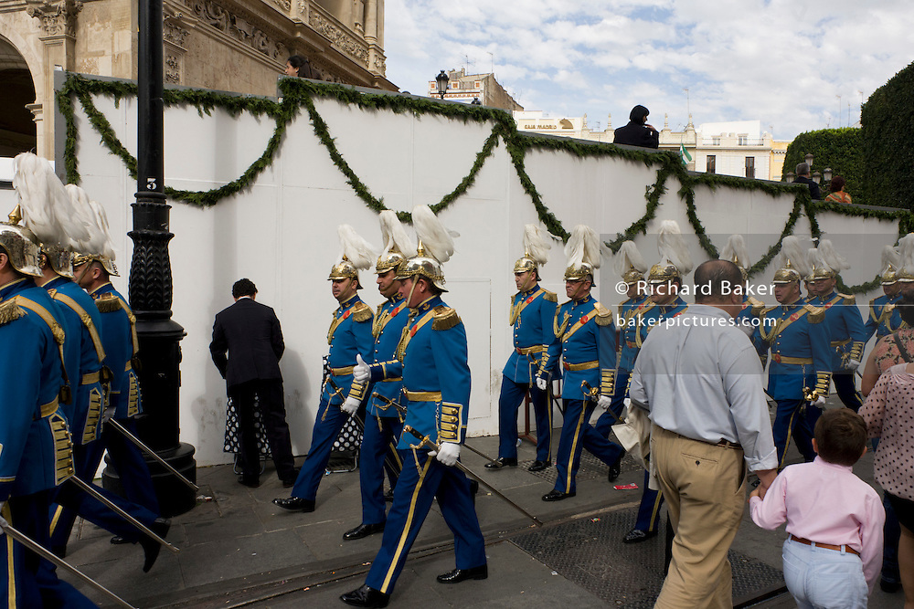 Uniformed musicians march through the city of Seville after religios Easter parades during Semana Santa.