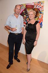 KITTY ARDEN and ED PARKER founder of Walking With The Wounded at a reception to launch Prestat's special edition of their award-winning chocolate bars to raise money for the charity Walking with the Wounded held at Sladmore Gallery, Bruton Place, London on 10th October 2013.