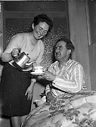 16/04/1960<br /> 04/16/1960<br /> 16 April 1960<br /> Thomas Murphy hunger striker wins. Daughter Mary pours her father, Thomas's first cup of tea following the ending of his hunger strike that lasted 7 days. The 52 year-old Dundalk man started his protest because he felt he was being denied the right to carry on business through the refusal of the manufacturers to supply him with certain television sets. Father of seven children, he claimed that the manufacturers were under pressure from a neighbouring firm.