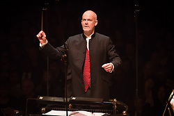 Conductor Pete Harrison performing with the Bournemouth Symphony Orchestra at Classic FM Live, at the Royal Albert Hall in London. The concert was part of Classic FM's 25th Birthday celebrations. Picture date: Tuesday September 19th, 2017. Photo credit should read: Matt Crossick/ EMPICS Entertainment.