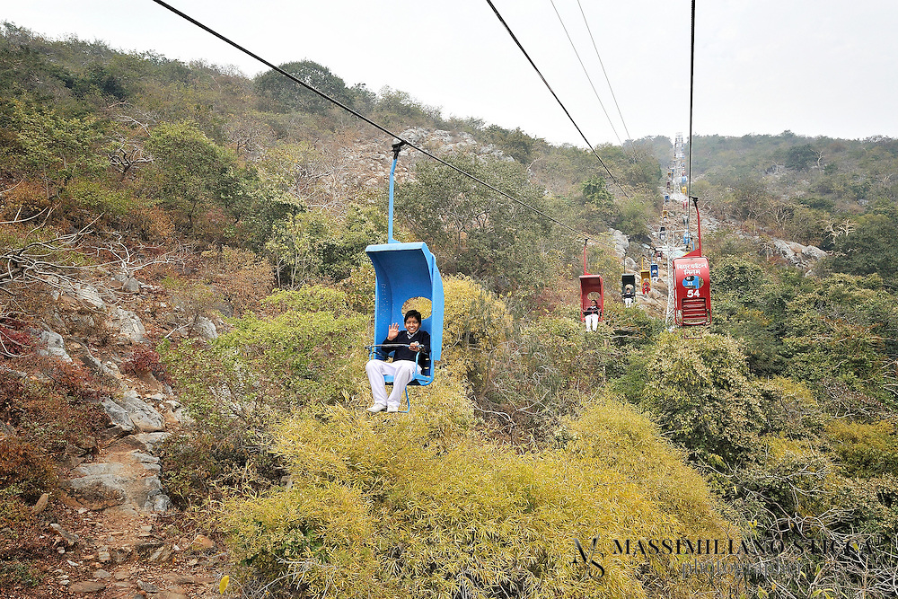 An aerial ropeway provides the link with a hill-top Vishwa Shanti Stupa [ World Peace Pagoda], and monasteries built by Japanese devotees atop the  Ratnagiri hills.<br /> The Rajgir  chair-lift aerial ropeway is said to be the oldest ropeway in the country. It was donated by famous Japanese monk Fuji Guruji.  The first person to ride on this ropeway was Loknayak Jaya Prakash Narayan!!!  Presently it is said to be the biggest revenue- generating unit of the Bihar State Tourism Development Corporation (BSTDC). There are talks of commissioning of the new ropeway.  The new ropeway would have cabins which would accomodate several persons, as against the existing chair-lift ropeway,  which can accommodate only one person . Once new one is installed,  the old one will be given the heritage status on the pattern of the famous toy train of Darjeeling.