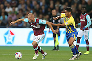 Gokhan Tore of West Ham United breaks away from Zak Vyner of Accrington Stanley. EFL Cup, 3rd round match, West Ham Utd v Accrington Stanley at the London Stadium, Queen Elizabeth Olympic Park in London on Wednesday 21st September 2016.<br /> pic by John Patrick Fletcher, Andrew Orchard sports photography.