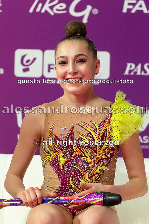 Gaia Garoffolo sitting at the Kiss and Cry of the Rhythmic Gymnastics World Cup in Pesaro.