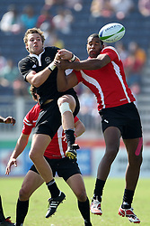 Tim Mikkelson of New Zealand battles for the high ball during the XIX Commonwealth Games 7s rugby match between New Zealand and Canada held at The Delhi University in New Delhi, India on the  11 October 2010..Photo by:  Ron Gaunt/photosport.co.nz