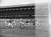 Player kicks ball towards goal during the All Ireland Minor Gaelic Football Final Cork v. Mayo in Croke Park on 24th September 1961.
