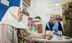 26 February 2020, Abu Dis, Palestine: 87-year-old Diabetes patient Hamama Jaffal (left) from Abu Dis receives nutritional advice from dietitian Samah Khatib (right) as she visits the Augusta Victoria Hospital's Mobile Diabetes Clinic. In an effort to make Diabetes services more accessible to people in the West Bank, the Augusta Victoria Hospital offers a Mobile Diabetes Clinic, which moves around to various locations in the West Bank, offering screening and routine testing for Diabietes and the symptoms it causes.