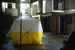 © Licensed to London News Pictures. 06/02/2021. London, UK. A forensic tent covers a body inside a courtyard at a block off flats on Wisbeach Road. Metropolitan Police are investigating multiple incidents of serious violence, including a fatal stabbing, in south London. One case was reported at 20:08GMT on Wisbeach Road, Croydon, where two males had suffered stab injuries. One male was taken to hospital prior to police arrival; condition not life-threatening. Another male was found at the scene. Despite the best efforts of paramedics, he was pronounced dead at the scene. Photo credit: Peter Manning/LNP