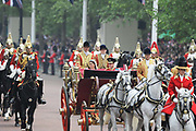 The newly titled Prince William and Catherine, Duchess of Cambridge travel to Buckingham Palace in the 1902 State Landau, along the procession route, waving and smiling as they go. The Royal Wedding of Prince Charles and Kate Middleton, London 29th April 2011. Crowds gathered to line the streets on this important day for the Royal Family.