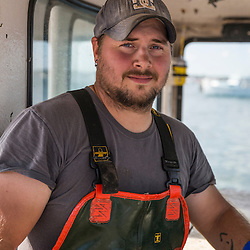 Sternman Mark Bickford in the wheelhouse of the boat, 'Miss Carol,' at Great Wass Lobster in Beals, Maine.