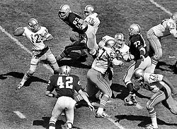 Raiders vs. 49ers..QB John Brodie,with Walt Rock, and Len Rohde...Oakland Raiders Ben Davidson, Bill Laskey,Issac Lassiter. (1967 photo/Ron Riesterer)