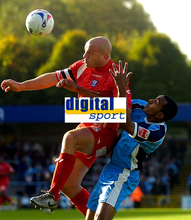 Photo: Alan Crowhurst.<br />Wycombe Wanderers v Peterborough United. Coca Cola League 2. 21/10/2006. 'Boro captain Guy Branston (L) clears the ball.