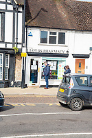 Lloyds Pharmacy  stratford upon avon marking out safe distance for customers to queue out side their shop