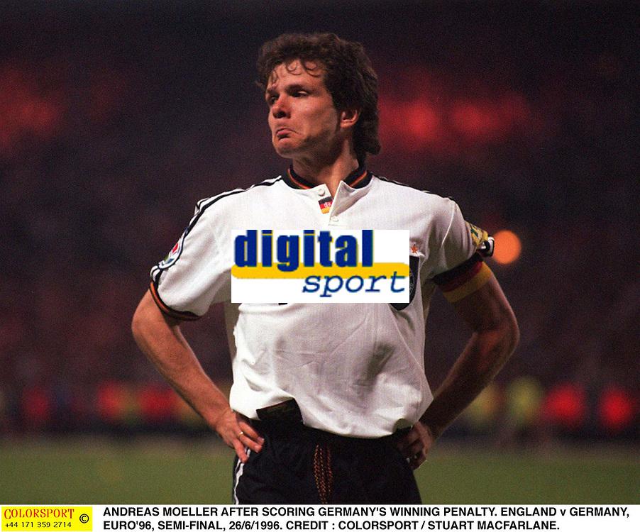 ANDREAS MOELLER AFTER SCORING GERMANY'S WINNING PENALTY. ENGLAND v GERMANY, EURO'96, SEMI-FINAL, 26/6/1996. CREDIT : COLORSPORT / STUART MACFARLANE.