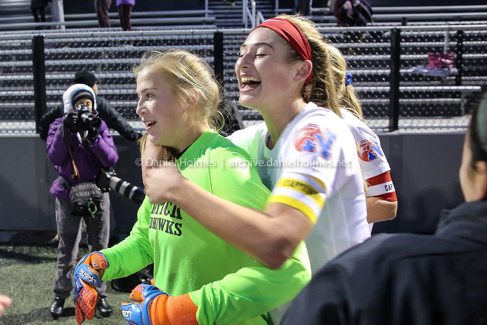 (11/12/18, HINGHAM, MA) Natick's Alex Campana, right, leaps onto goalkeeper Ashley Bianco after the Redhawks 2-1 win over Newton South in the Division 1 South girls soccer sectional finals at Hingham High School on Monday. [Daily News and Wicked Local Photo/Dan Holmes]