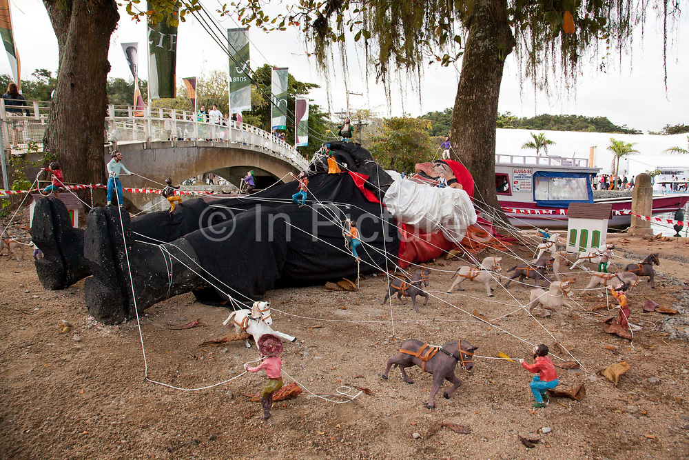 A scullpture showing a scene from Gulliver's travels of Gulliver being tied up, Paraty, Rio de Janeiro, Brazil.
