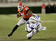 ATHENS, GA - NOVEMBER 23:  Running back J.J. Green #15 of the Georgia Bulldogs runs over defensive back Blake McClain #24 of the Kentucky Wildcats during the game at Sanford Stadium on November 23, 2013 in Athens, Georgia.  (Photo by Mike Zarrilli/Getty Images)
