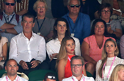 Dylan Brosnan, Keely Shaye Smith and Pierce Brosnan in the stands on day eleven of the Wimbledon Championships at the All England Lawn Tennis and Croquet Club, Wimbledon.