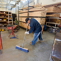 021213       Brian Leddy<br /> Dewayne Ramone sweeps the shop at the end of class Tuesday at Navajo Technical College. The school has over 60 students in the Construction Technology program.