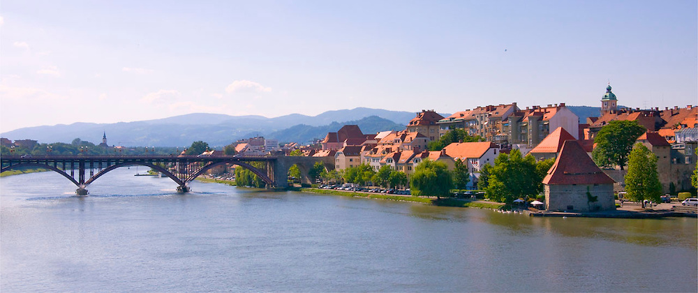 Red roofed houses in historic neighborhood of Lent by Drava River, Maribor, Slovenia