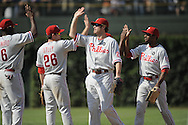 CHICAGO - AUGUST 13:  Chase Utley #26, Jayson Werth #28 and Ryan Howard #6 of the Philadelphia Phillies celebrate with teammates after the game against the Chicago Cubs on August 13, 2009 at Wrigley Field in Chicago, Illinois.  The Phillies defeated the Cubs 6-1.  (Photo by Ron Vesely)