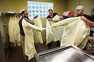27 JUNE 2015 -- near BALLWIN, Mo. -- Adil Imdad (left), Muhibin Socoro (partially obscured), Dzemal Bijedic and Albin Lolic, members of the funeral committee at the Islamic Foundation of Greater St. Louis, prepare to join family and friends of Velija Ascic to wash his body in the funeral offices at Daar-ul-Islam Masjid in Ballwin, Mo. Saturday, June 27, 2015. Washing and shrouding the body is part of a traditional Islamic funeral, services now being offered by the committee members. Ascic, 52, a truck driver from St. Louis, was killed Tuesday, June 23 in an accident in Wildwood, Fla., according to the Florida Highway Patrol. Photo © copyright 2015 Sid Hastings.