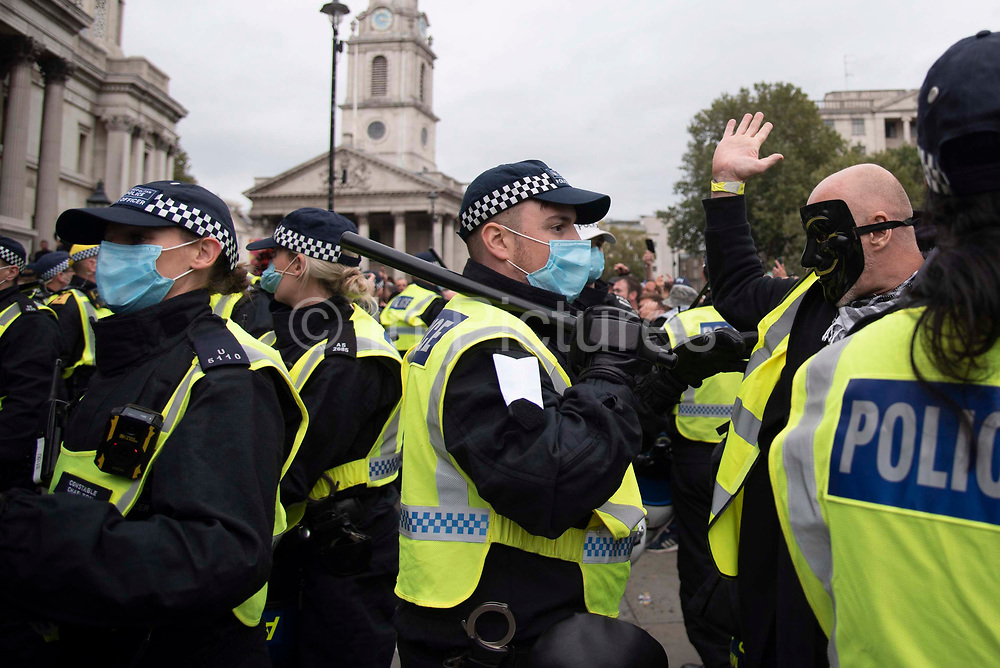 Police officers attempt to disperse protesters on 26th September 2020 in Trafalgar Square, London, United Kingdom. Over 2,000 demonstrators attend the 'We Do Not Consent!' rally against vaccination and government restrictions designed to fight the spread of  Covid 19, including the wearing of masks and taking tests for the virus.