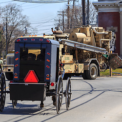 Intercourse, PA / USA - April 6, 2015: An Amish buggy travels on the main roadway through the Lancaster County village.