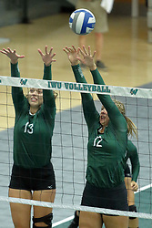 23 September 2017:  Rachel Burkman & Maddie Williams during an NCAA womens division 3 Volleyball match between the Tufts Jumbos and the Illinois Wesleyan Titans in Shirk Center, Bloomington IL
