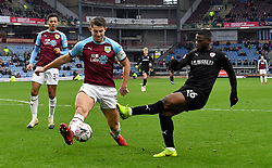 Burnley's James Tarkowski (left) and Barnsley's Mamadou Thiam (right) battle for the ball during the Emirates FA Cup, third round match at Turf Moor, Burnley.