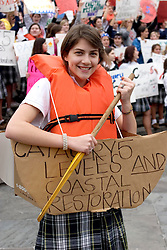 12 Jan 2006. New Orleans, Louisiana. Post Katrina.<br /> School girls from the academy of the Sacred Heart protest the lack of effective levees in New Orleans as President George Bush comes to town. 18 year old Madeline Baay protests with her fellow students.<br /> Photo; Charlie Varley/varleypix.com
