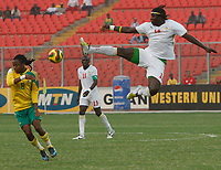 Photo: Steve Bond/Richard Lane Photography.<br />Senegal v South Africa. Africa Cup of Nations. 31/01/2008. Moustapha bayal Sall (L) in mid air. Siphwe Tshabalala (L) prepares for the worst