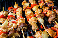 Chicken Shis kebab with mushrooms and peppers prepared over slow burning flame, barbecue style.