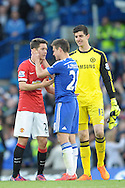Cesar Azpilicueta of Chelsea consoles Ander Herrera of Manchester United after the final whistle with Goalkeeper Thibaut Courtois of Chelsea lookng on. Barclays Premier league match, Chelsea v Manchester Utd at Stamford Bridge Stadium in London on Saturday 18th April 2015.<br /> pic by John Patrick Fletcher, Andrew Orchard sports photography.