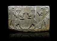 Photo of Hittite relief sculpted orthostat stone panel of Herald's Wall. Basalt, Karkamıs, (Kargamıs), Carchemish (Karkemish), 900-700 B.C. Anatolian Civilisations Museum, Ankara, Turkey.<br /> <br /> Protective mixed creatures. One each hand of the lion-headed men is in the form of a fist. The mace on the left is over the head of the weapon on the right. The two bull-men in the middle carry one spear each in their hands. Bull-man is known as Kusarikku, and the lion-man is known as Ugallu. <br /> <br /> Against a black background. .<br />  <br /> If you prefer to buy from our ALAMY STOCK LIBRARY page at https://www.alamy.com/portfolio/paul-williams-funkystock/hittite-art-antiquities.html  - Type  Karkamıs in LOWER SEARCH WITHIN GALLERY box. Refine search by adding background colour, place, museum etc.<br /> <br /> Visit our HITTITE PHOTO COLLECTIONS for more photos to download or buy as wall art prints https://funkystock.photoshelter.com/gallery-collection/The-Hittites-Art-Artefacts-Antiquities-Historic-Sites-Pictures-Images-of/C0000NUBSMhSc3Oo