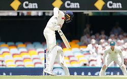 England's Stuart Broad is hit by a short delivery during day two of the Ashes Test match at The Gabba, Brisbane.